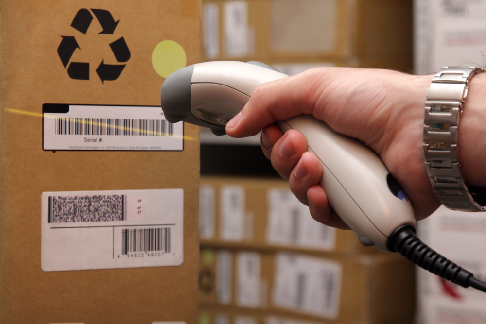 Man hand with barcode scanner in operation.